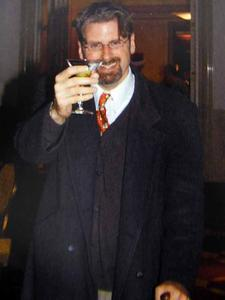 Farrell giving a toast at a company holiday party