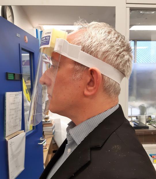 Digital Journal s Tim Sandle models a face shield.
