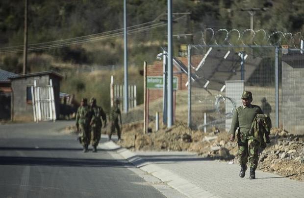 Soldiers walk inside the Makoanyane Barracks in Maseru on September 1  2014