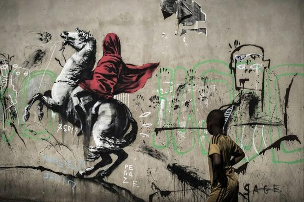 Street artist Banksy's version of Napoleon Bonaparte inspired by the iconic portrait of Jacques...