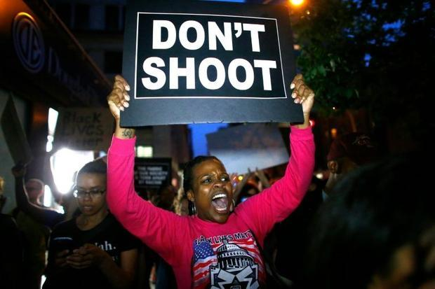 Hundreds of people marched peacefully in New York for a third consecutive night as part f nationwide...