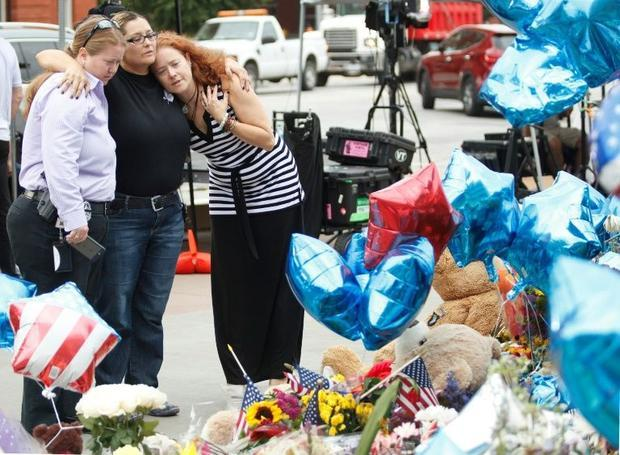 Holland Barton (L)  Elaine Hassmann and Michelle Weisskopf (R)  all members of the Dallas Police Dep...