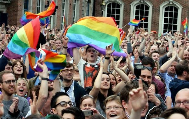 Supporters react outside Dublin Castle following the announcement of the result of the same-sex marr...