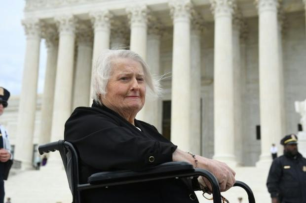 Transgender activist Aimee Stephens (pictured October 2019) sits in her wheelchair outside the US Su...
