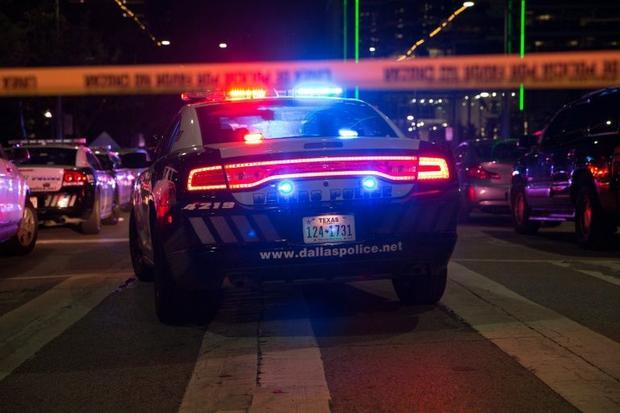 Police cars sit on Main Street in Dallas followinga shooting during at a large protest in the US cit...