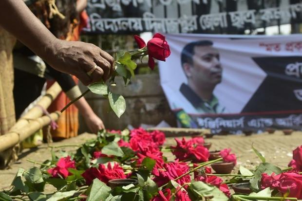 A Bangladeshi activist pays his respects to slain blogger Avijit Roy  who was killed on February 26
