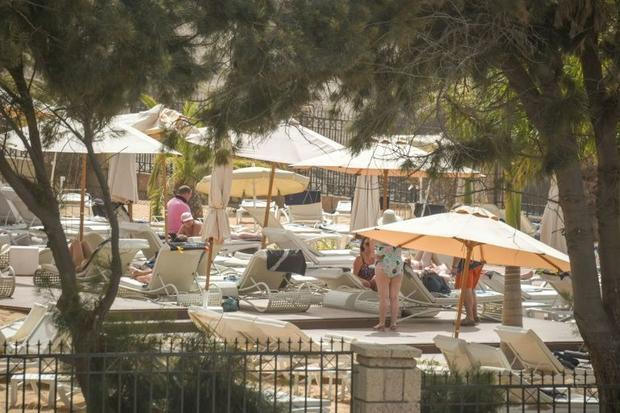 Some tourists made the most of the shutdown to sunbathe by the pool