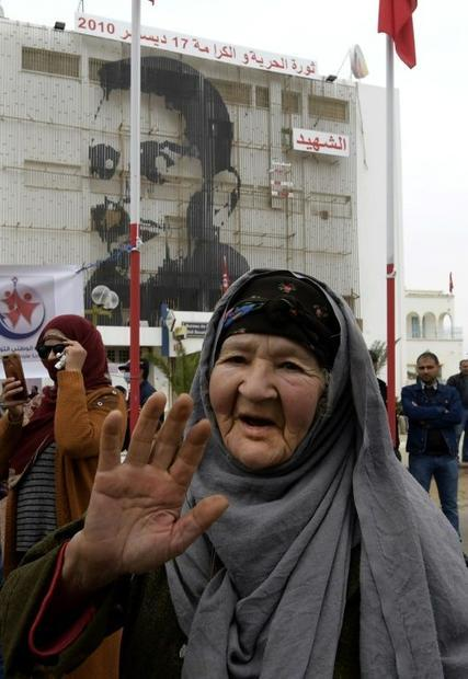A December 17 picture shows commemorations 10 years after the self-immolation of Tunisian street ven...