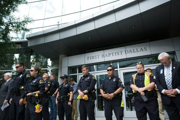 Police officers join parishioners of First Baptist Church in Dallas  Texas  as they gather on July 1...