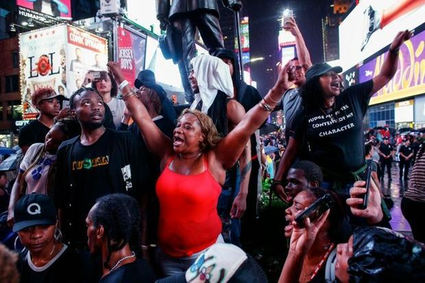 Protestors shout slogans during a protest in Times Square in support of the Black lives matter movem...