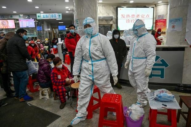 In the Wuhan hospitals visited by AFP  people queue up in long lines to see a doctor. The wait is so...
