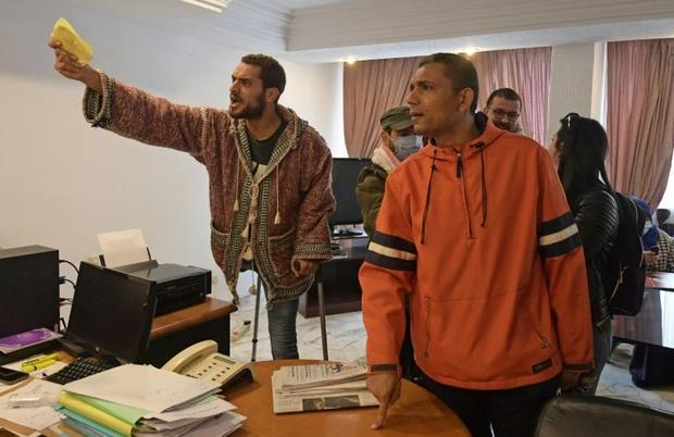 Former Tunisian protesters who were injured during the revolution demand recognition and compensatio...