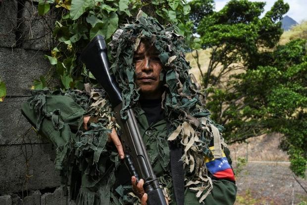 Ismaira Figueroa  a sniper for the Bolivarian militia  carries a Belgian-made 7.62 mm caliber FAL ri...