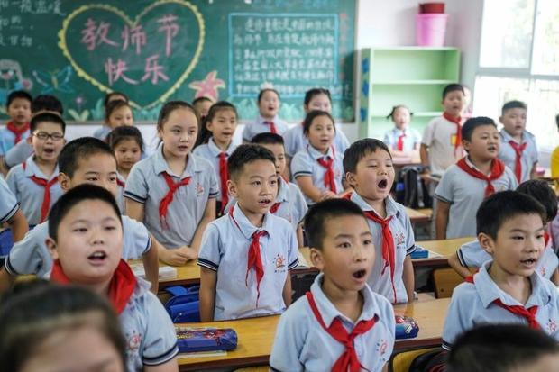 Elementary school students attend a class on the first day of the new semester in Wuhan