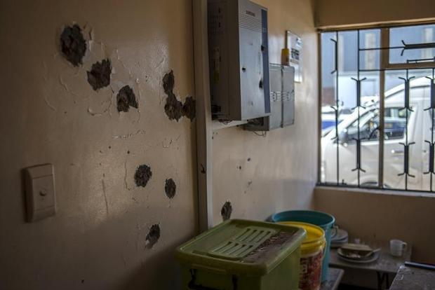 Bullet holes cover a wall at the Hamabote police station in Maseru on September 2  2014 a few days a...