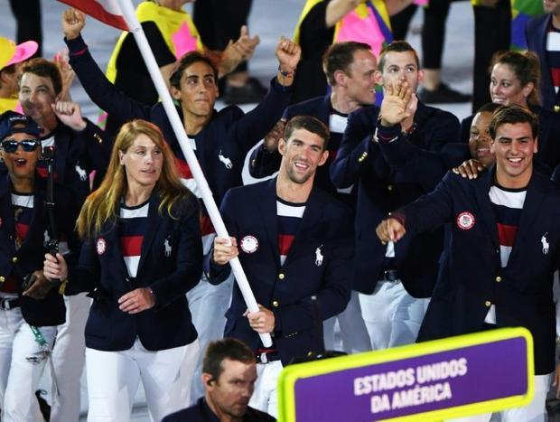 United States flagbearer Michael Phelps leads his delegation during the opening ceremony of the Rio ...