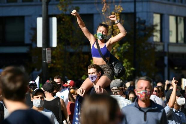 People celebrate Joe Biden's victory  on Black Lives Matter Plaza across from the White House