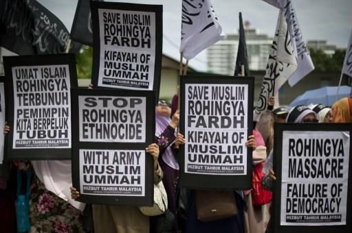 Malaysian Muslim activists in Kuala Lumpur on February 14  2014 display placards during a peaceful p...