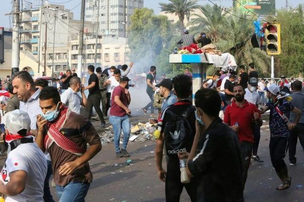 Protestors were targeted by tear gas in Tahrir Square in Baghdad  with some students bringing kits t...