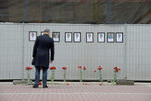 Outside the health department in Saint Petersburg stands a makeshift memorial to Russian medical wor...