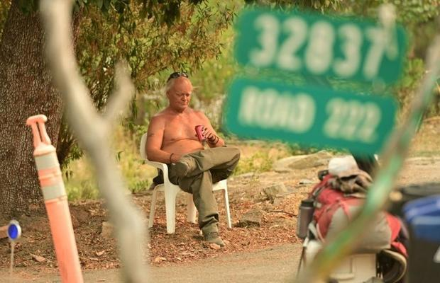 Evacuee Clay Brazil waits to be picked up during the Creek Fire in the North Fork area of unincorpor...