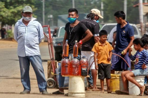 People offer gasoline for sale on the streets of Maracaibo  Venezuela in July 2020