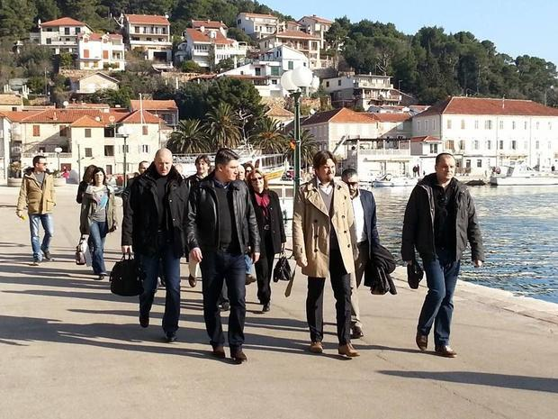 Prime Minister Milanovic (left) was treated to a walking tour of the Jelsa waterfront upgrade by Jel...