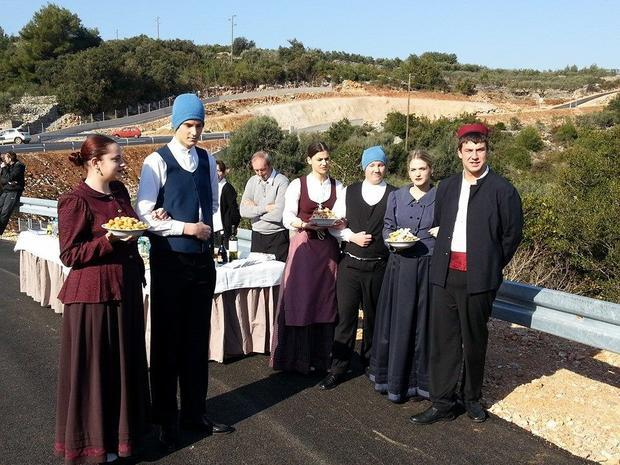 The Jelsa welcoming committee inluded KUD Jelsa in traditonal dress  serving local delicaces.