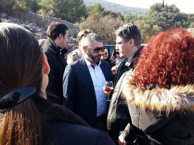 Prime Minister Milanovic enjoys the opening of Croatia s latest new road with a glass of Tomic Prose...
