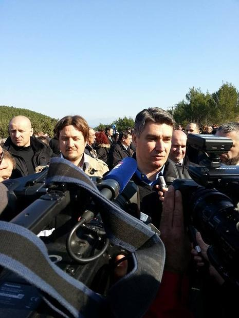Prime Minister Milanovic gave a press conference at the road opening  flanked by Jelsa Mayor Niksa P...