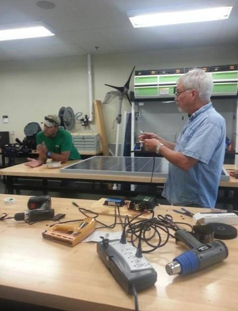 A group of college faculty and students are partnering with the non-profit High Hopes to build solar...