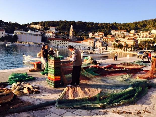 One of Europe s most exclusive waterfronts in July  the Hvar riva gives way to fishing nets and fish...